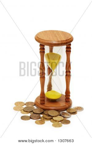"""Time Is Money"" Concept - Hourglass And Coins"