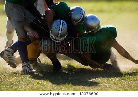 Football players are is serious action.