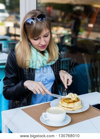 Beautiful Young Woman Eating Breakfast