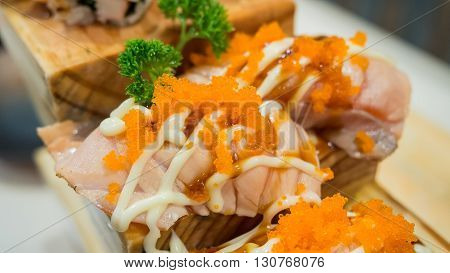 Close-up grilled Salmon sushi with tobiko and mayonnaise