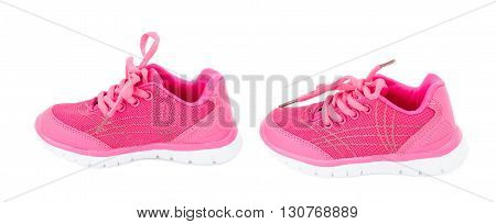 Pair of pink training shoes for girls. Isolated on a white background.