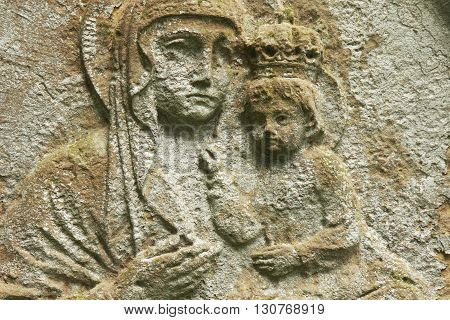 statue of the Virgin Mary with the baby Jesus Christ in her arms (fragment of antique statue)