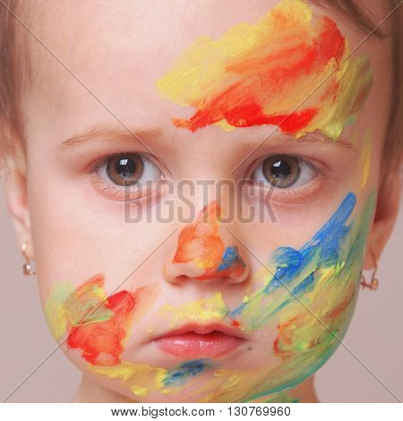 beautiful little baby girl doing make up (humorous picture)