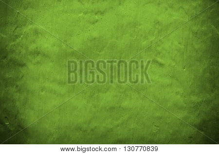 green painting on concrete wall