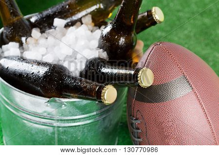 American football with a cold beer in a bucket