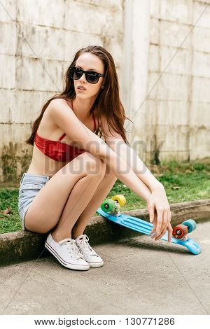 Cute Hipster Girl In Bikini With Skateboard.