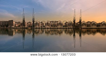These are cranes in the dock. The location is london on the bank of Thames.