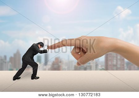 Small Man Pushing Against Big Woman Hand