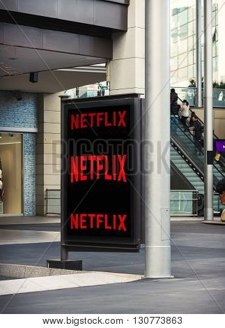 BARCELONA SPAIN 13 JANUARY 2016: Netflix logo on billobard at shopping center. Netflix is an international leading subscription service for watching TV episodes and movies.