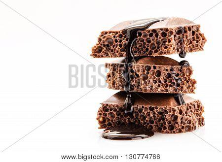 part porous chocolate isolated on white background