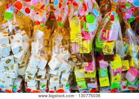 Colorful nougat selling in a french market. Local specialty Normandy France.