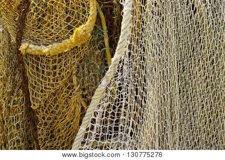 Fisherman's nets in old French harbor background