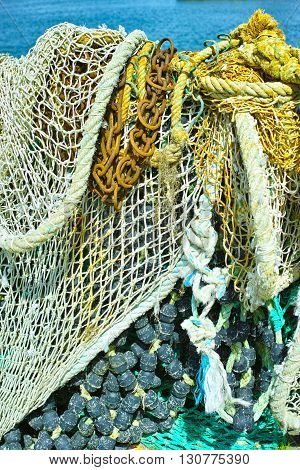 Fisherman's nets and old iron chain background