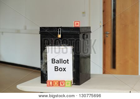 Ballot box with childrens' ABC blocks spelling