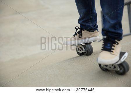 freeline skateboarder legs riding on freeline at skatepark