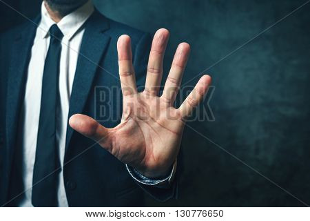 Businessman with long fingers concept of relation between body parts and intelligence