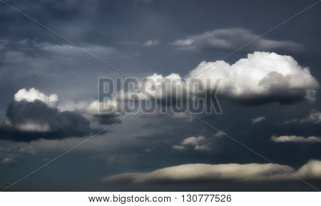 Dark, ominous, dramatic grey skies with storm clouds