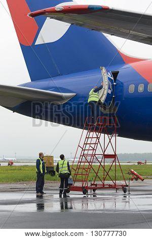 Service Engineer Opens The Plane Door