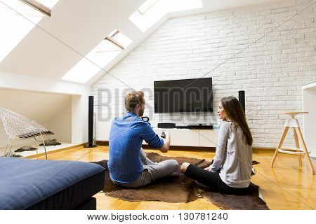 Couple With A Tv Remote Control