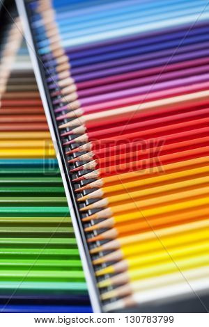 Color pencils spectrum/ crayons in rows background