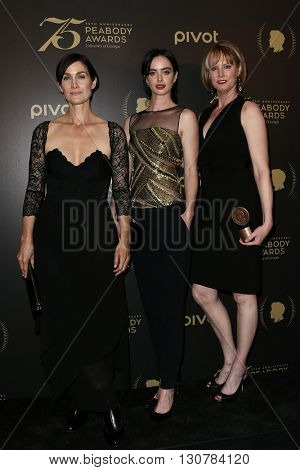 NEW YORK-MAY 21: (L-R) Carrie-Anne Moss, Krysten Ritter and Melissa Rosenberg attend the 75th Annual Peabody Awards Ceremony at Cipriani Wall Street on May 21, 2016 in New York City.