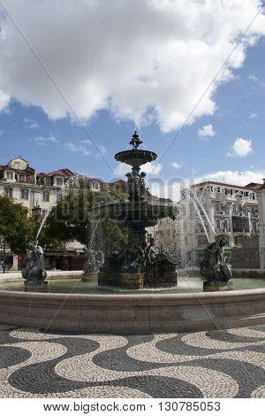 Fountain on Dom Pedro IV square in Lisbon Portugal