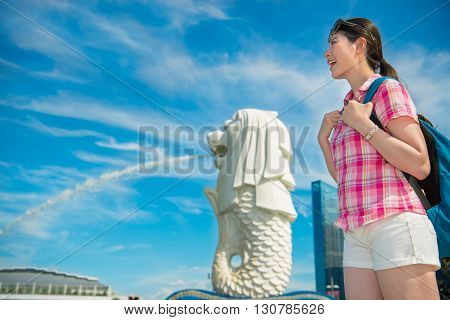 Happy Asia Woman Travel In Singapore, Merlion Park