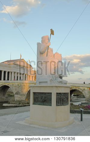 Macedonia Skopje Emperor Iusinianus Statue Stone Bridge and Archeological Museum in the background sunset