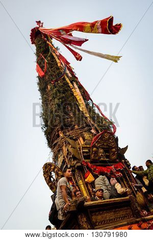 PATAN, NEPAL - MAY 19, 2016: God of rain Rato Machhindranath chariot festival. Rato Machhindranath is worshiped as the god of rain. The chariot is pulled through the street of Patan for about a month.