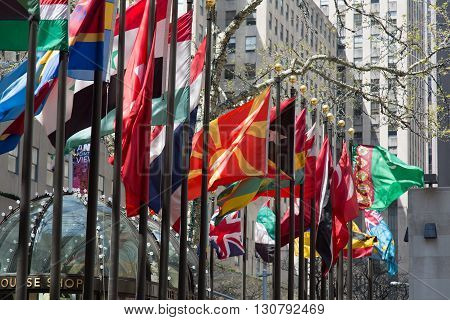 NEW YORK, USA - APRIL 21, 2016: Flagpoles display flags of United Nations member countries around the Rockefeller plaza. There are some 200 of them.