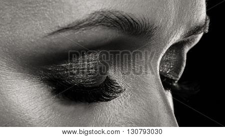 Beautiful, expressive eye make-up girl, dark eyeliner.