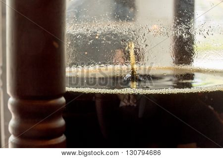 Coffee dripping in wooden cold brew drip