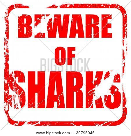 Beware of sharks sign, red rubber stamp with grunge edges