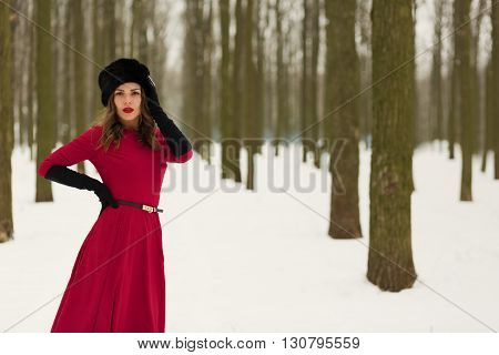 Beautiful Woman In Winter Forest