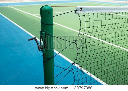 Poles and nets in the tennis court.