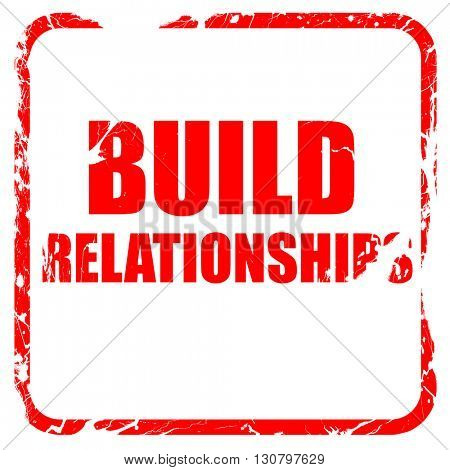 build relationships, red rubber stamp with grunge edges