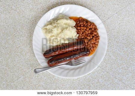 top view sausages baked beans and mashed potato