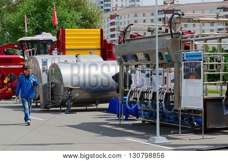 GOMEL BELARUS - MAY 19 2016: Unidentified man inspects equipment for food industry and agriculture in open air during XVII International Universal Exhibition-Fair