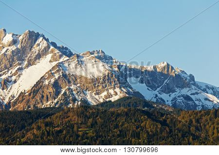 Landscape of snowy Alpine peaks shown in close-up in the light of the morning