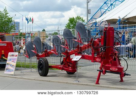 GOMEL BELARUS - MAY 19 2016: Plough five corps semi-mounted reversible PO-4+1-40K in the open air during the XVII International Universal Exhibition-Fair