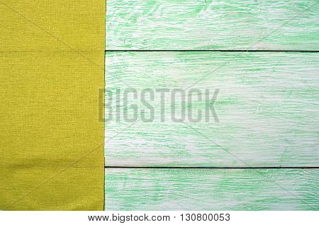Tablecloth green textile on wooden green background