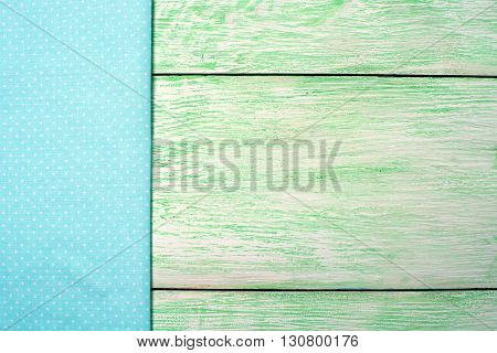Tablecloth blue textile on wooden green background
