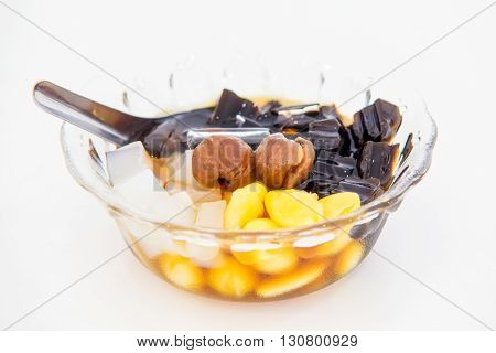 Traditional chinese dessert a delicious bean and herb in longan syrup with ice isolation on white