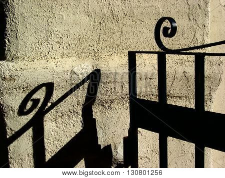 a picture of an exterior 19th century fence and adobe wall