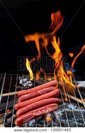Grill concept. Grilling sausages on barbecue grill. Selective focus