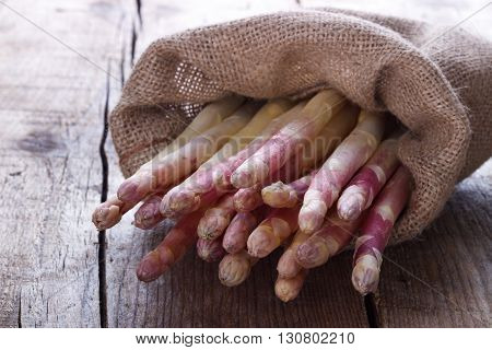 Bunch of fresh white asparagus on old wooden board