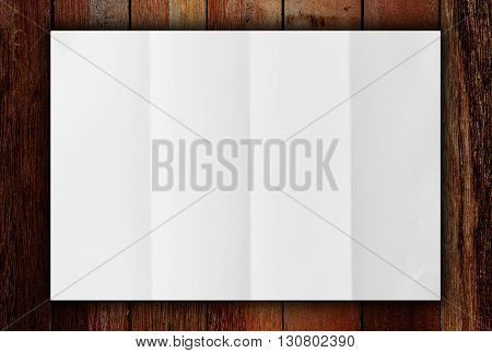 White blank paper on wooden table background