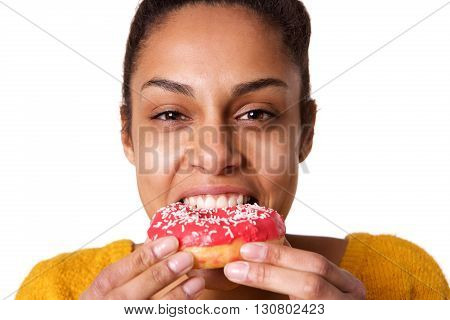 Hungry Young Woman Eating Donut