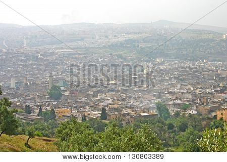 Hazy day obscures buildings in the city of Fez Morocco