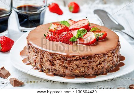 milk chocolate cheesecake with milk chocolate icing and strawberries